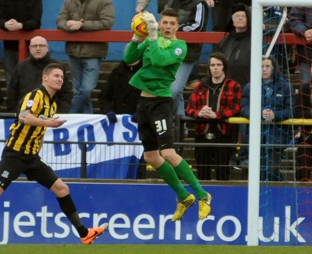Nick Pope gathers in the ball during the clash against Southend