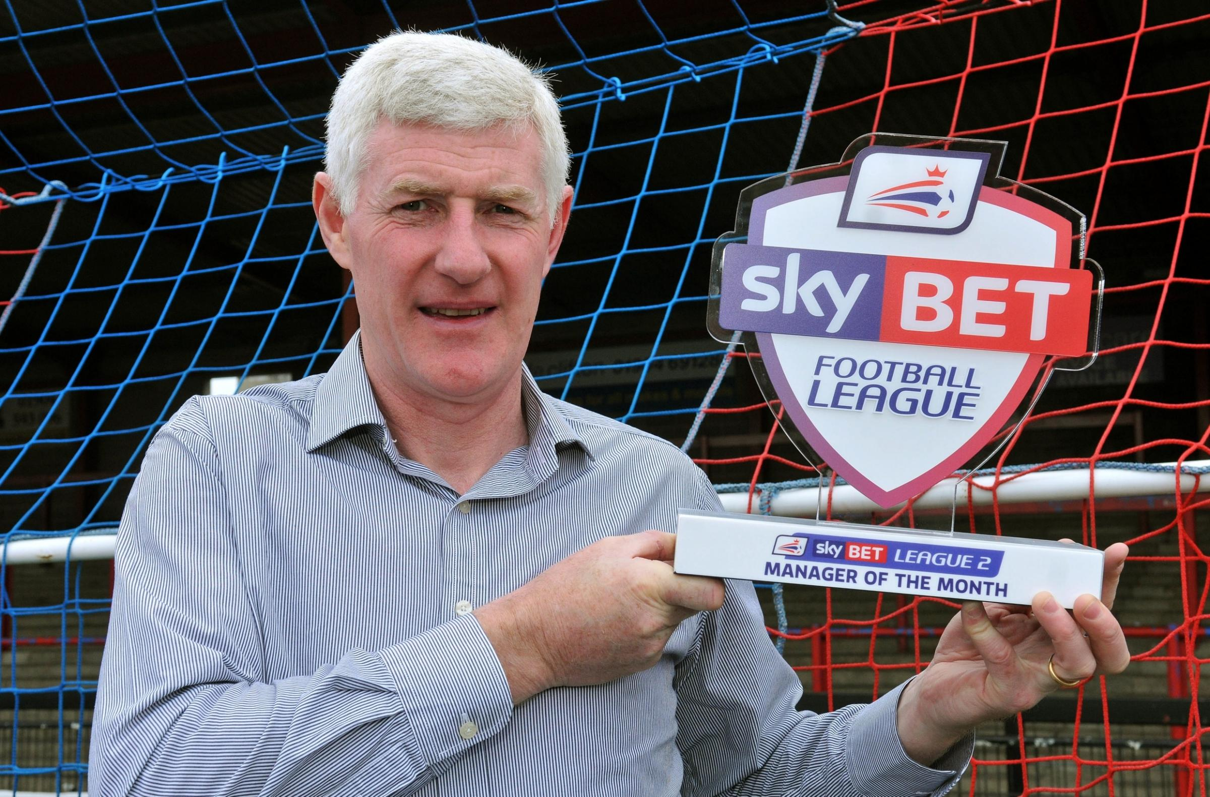 SKY BET GONG: York City boss Nigel Worthington with his Sky Bet League Two manager of the month award for March