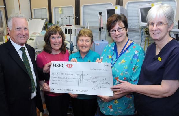 York Press: Dennis and Rachel Jones present the cheque to, from left, Bernie Wood, Judith Hills and Ann Elliott at York Hospital's Special Care Baby Unit