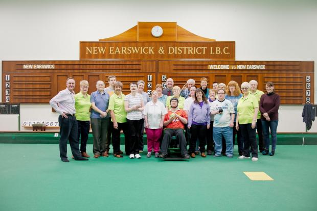 Jeremy Ince of Charity Bank left, and second right, Andy Webster, manager at New Earswick Bowls Club, with club volunteers and members, some of which represented Yorkshire & Humberside in the 2013 National Special Olympics Games