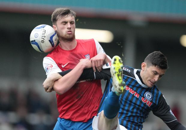 York City's Tom Allan tussles with a Rochdale player during his return to the side at left-back
