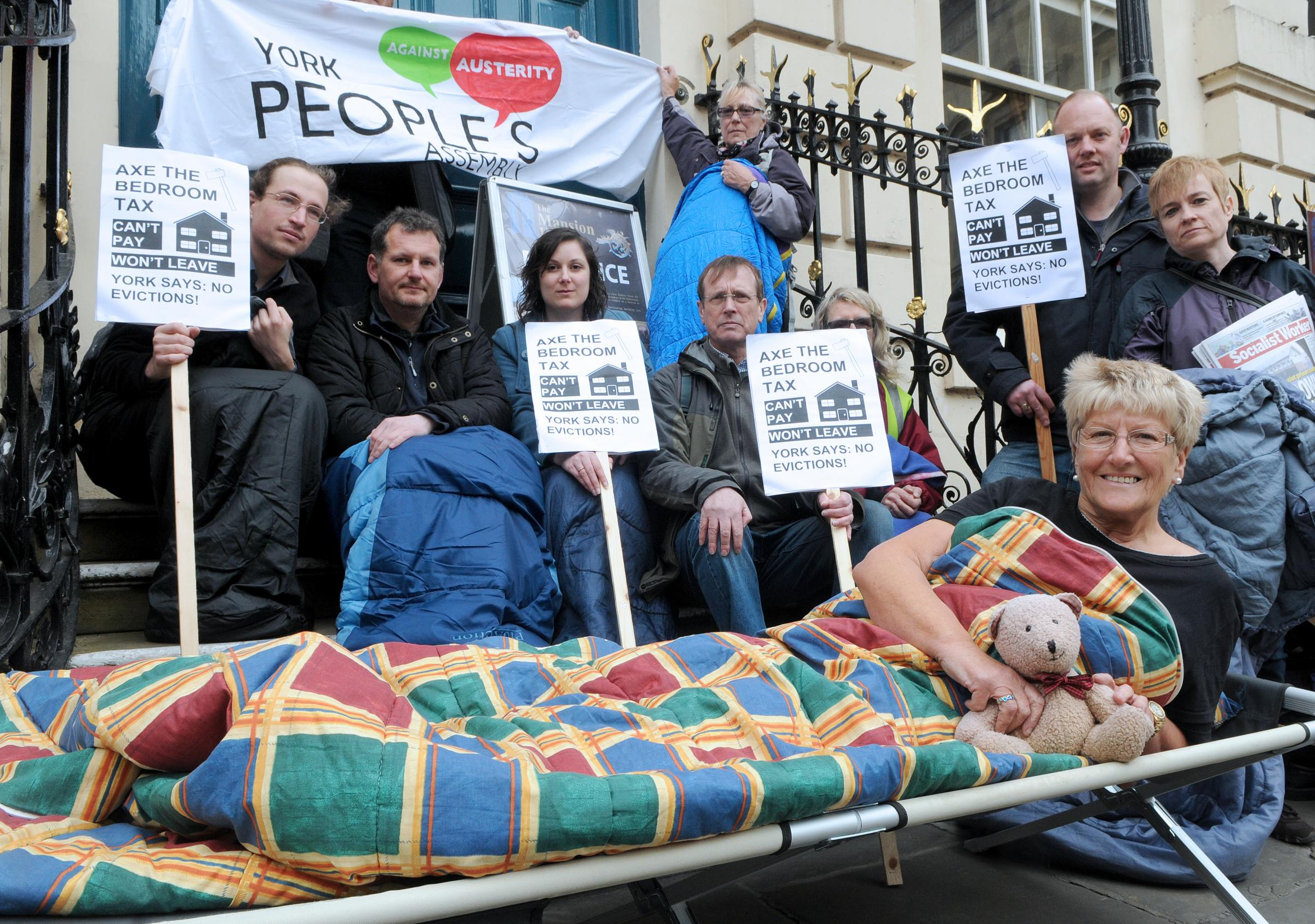 Gwen Vardigans, foreground, and other members of the York People's Assembly during the 'bedroom tax' protest outside the Mansion House.