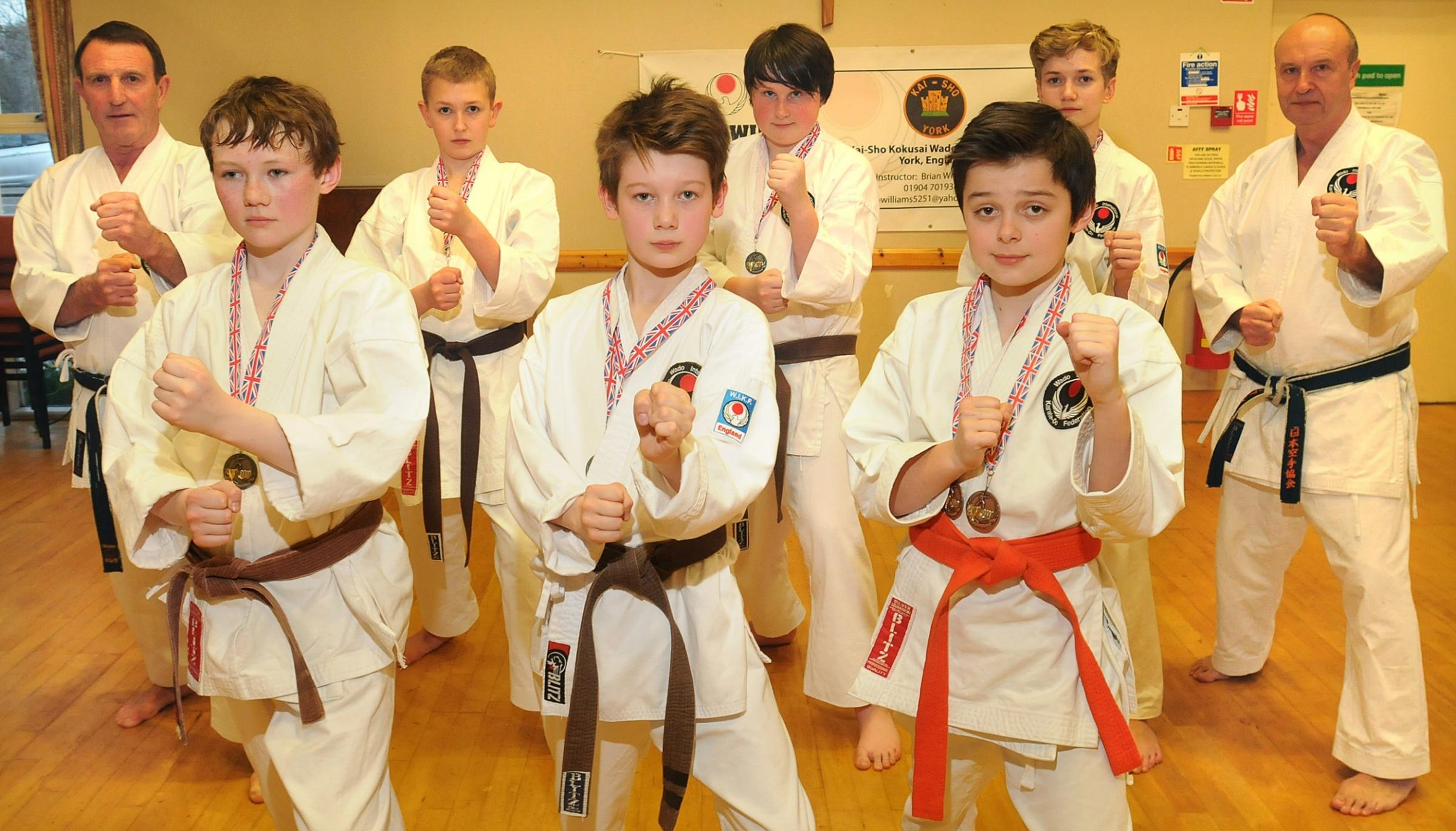 Kai-Sho Karate Club instructors Brian Williams, left, and Brian Hughes, right, with medal winners at the WIKF National Championships, from left, Henry Rice, Owen Lewis, Angus Gibby, Joseph Curtis, Harry Johnson and Jack Scott