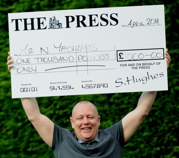 WINNER: Neil Yeomans celebrates his £1,000 York Press win                                                                  Picture : Garry Atkinson