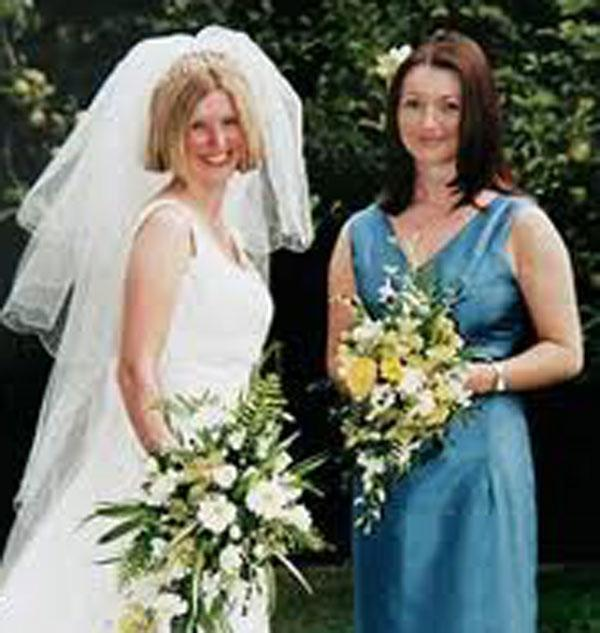 Claudia Lawrence, right, on her sister Ali's wedding day in 1999