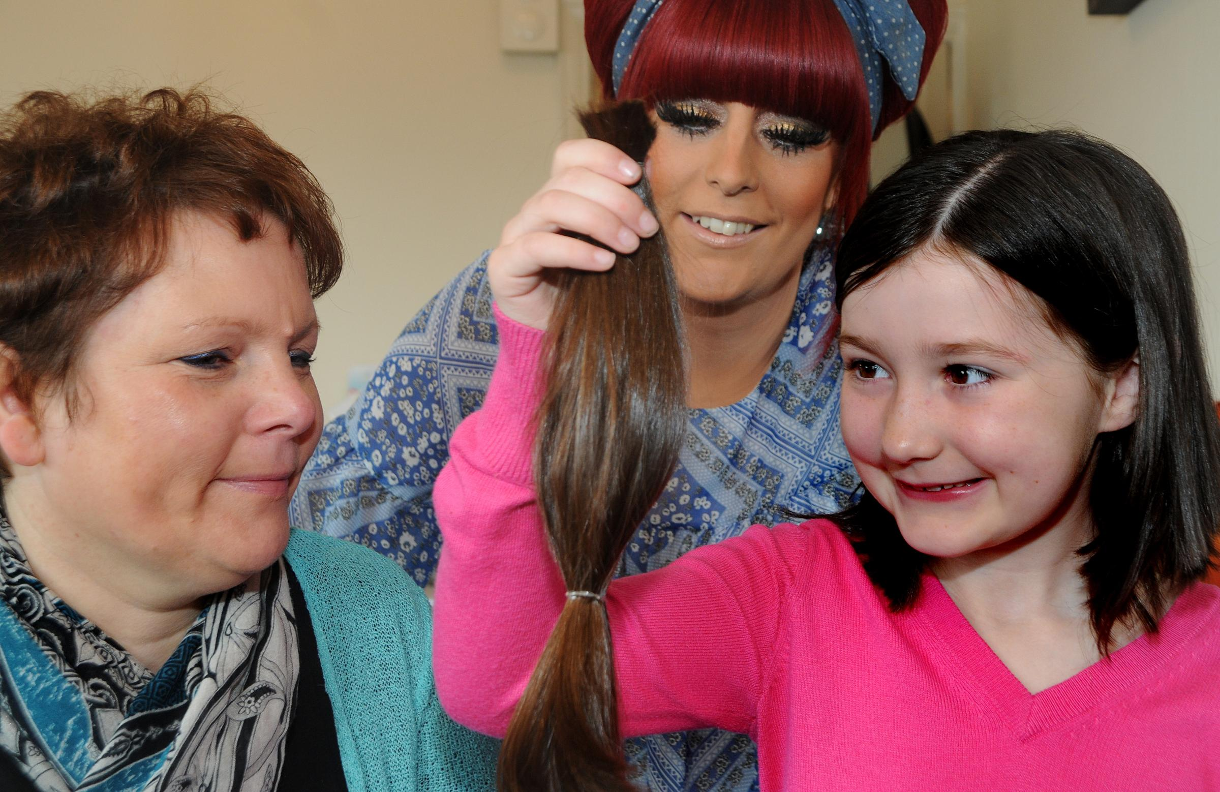 Pictured at the Inovations hair salon on Boroughbridge Road is Eleanor Phillips, aged 7, who had her hair cut short to raise money for the Leeds Teaching Hospital and the Ann Conroy Trust. Pictured with Eleanor are Ange Fenton and Jessica Morgan