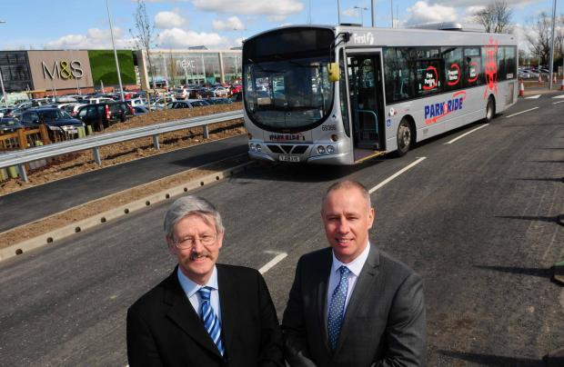 VAN-TASTIC SERVICE: Coun Dave Merrett and Will Pearson, of bus company First, at the new Vangarde shopping centre.