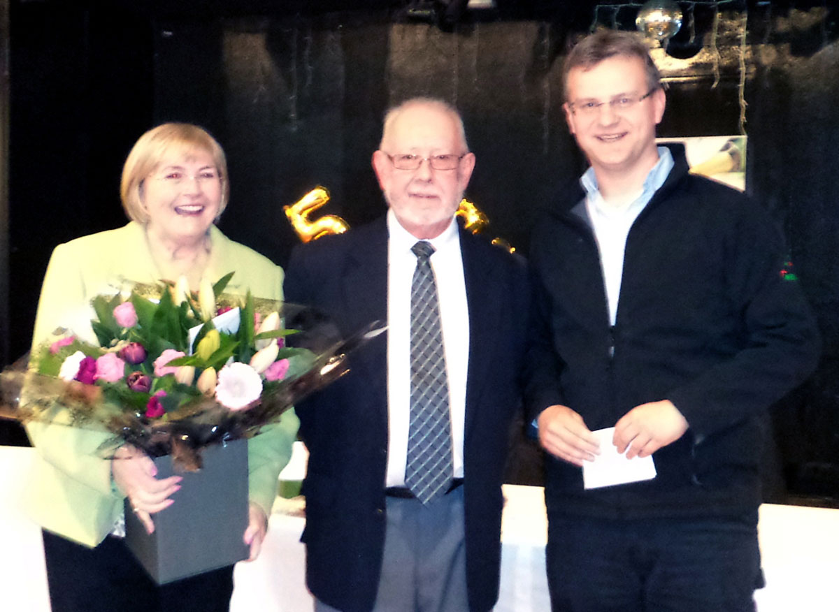 John Smith's Tadcaster Brewery general Manager Martin Kochl (right) presents Mick and his wife Ann with gifts and flowers to mark his retirement