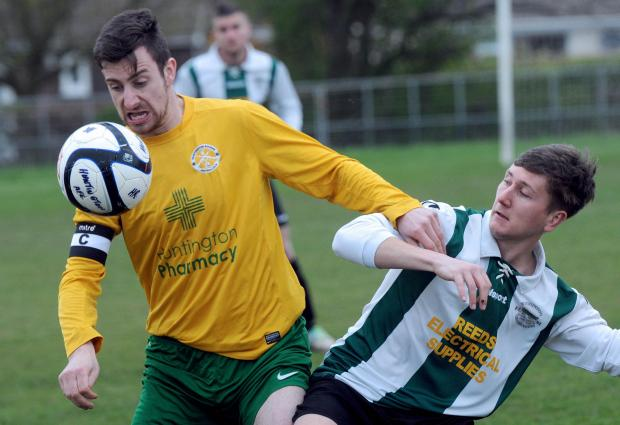 Huntington Rovers captain Gary Newton, left, and Wigginton Grasshoppers' Matthew Tiplady battle for possession in the York Minster Engineering League premier division
