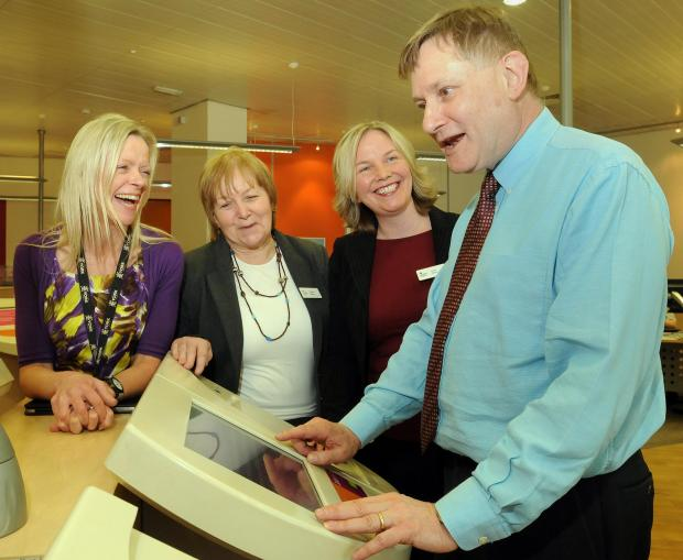 Hugh Bayley uses the Job Point during his visit to Jobcentre Plus in Stonebow in York