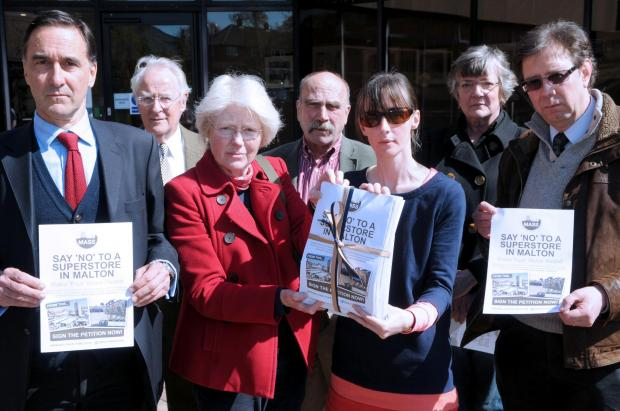 Presenting their petition, against plans to build a supermarket on Wentworth Street, at the Ryedale District Council offices (from left) Roddy Bushell, Paul Beanland, Emma Brooksbank, Howard Croft, Helen Lowdell, Fiona Croft and Jeremy Powell.