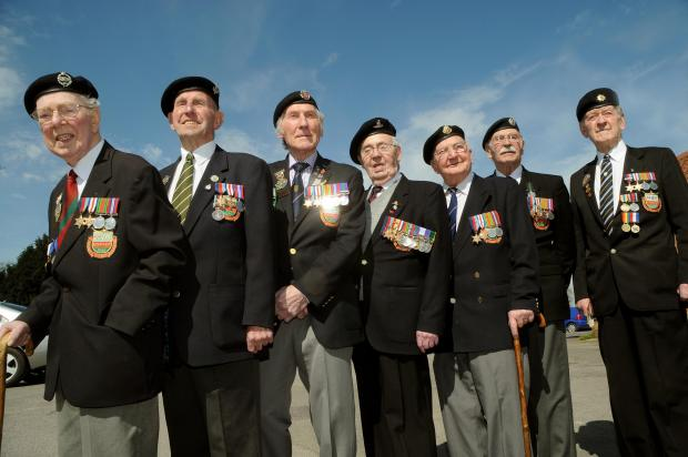 Normandy Veterans. From the left are Gordon Collinson, Ken Cooke, Ken Smith,  Roy Rowbotham, Bert Barritt, George Meredith and Douglas Haw. Picture David Harrison. (5489669)