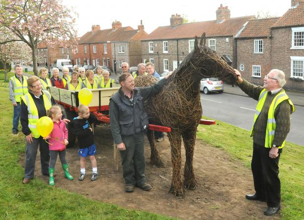 Foreground. Stuart Jacques and (right) Chairman Roy Freer with members of Dunnington in Bloom and their horse and cart which will form part of their display in the village this year.