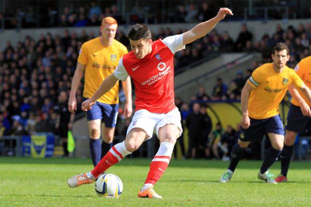 York City forward Michael Coulson scores from the penalty spot at Oxford