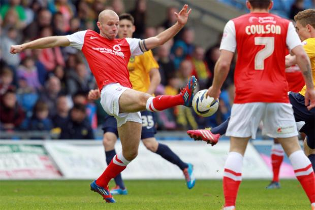 York City skipper Russell Penn puts his foot in during Good Friday's 1-0 win at Sky Bet League Two play-off rivals Oxford United