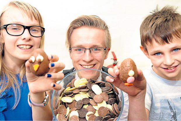 Harry Lee, Head of Social Media at the York Festival of Chocolate,  with youngsters and the decorated eggs they created as part of the festival events