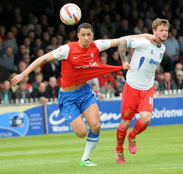 (Left) York City'sLewis Montrose and Bury's Andrew Tutte in action during the match at Bootham Cresent. Picture : Garry Atkinson