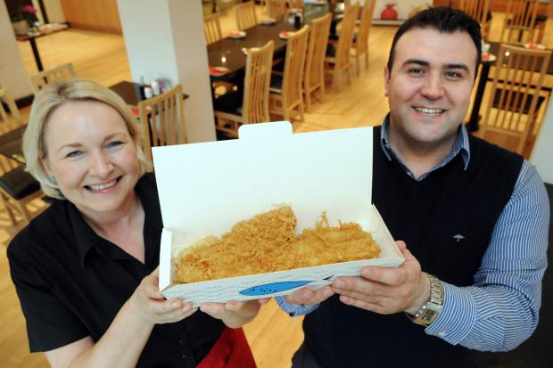 Tim Erimham, owner of Tritons fish and chip restaurant, and its manager, Dawn Ozakinci, who are holding a fundraising weekend for Oscar Hughes