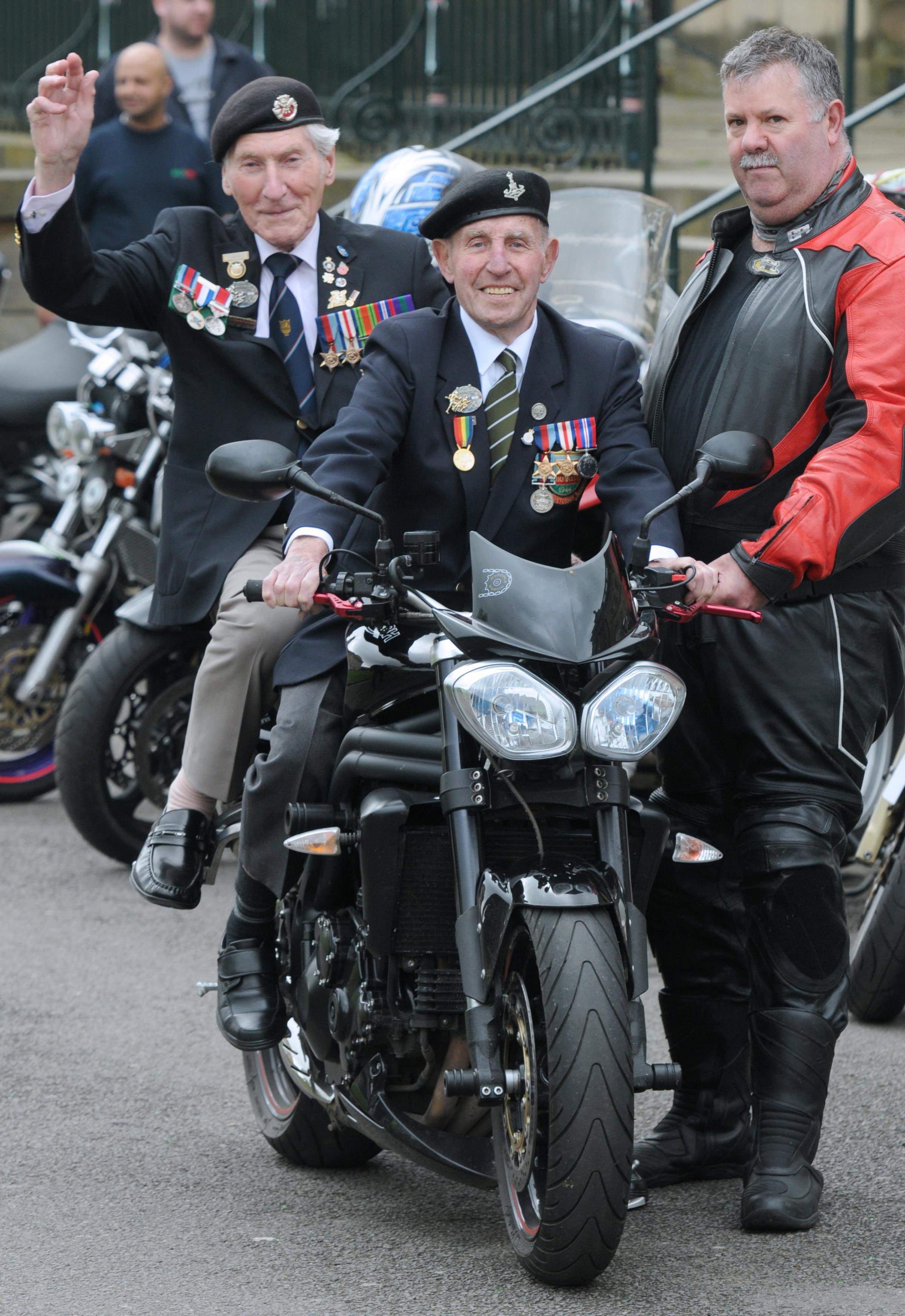 Normandy veterans Ken Smith (left) and Ken Cooke, try out a Triumph motorbike for size at the Eye of York, the start point for the fundraising ride, with bike owner Andy Wood of Ryedale Riders.