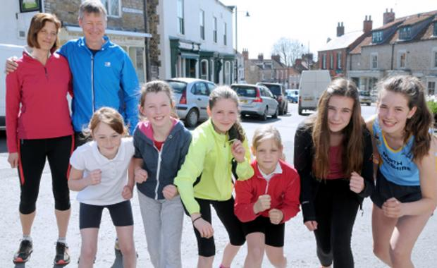 Kirkbymoorside 10k organisers Rick and Catherine Eve with young runners, from left, Ebony Simm, Evie Cass, Georgina Eve, Beth Cussons, Shannon Crossland and Harriet Eve