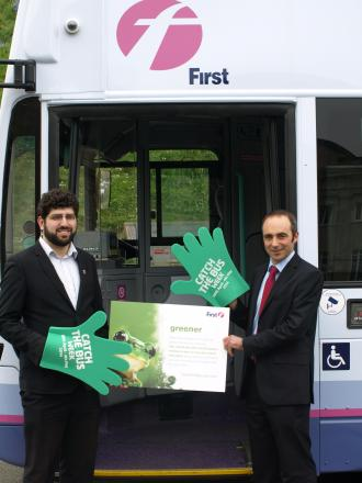 Cllr David Levene and First managing director Ben Gilligan, pictured by one of the new hybrid buses