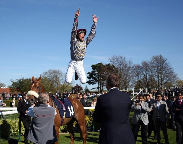 York Press: Frankie Dettori does a flying dismount after riding Sandiva to beat Euro Charline in the Nell Gwyn Stakes at Newmarket. Picture: Steve Parsons/PA Wire