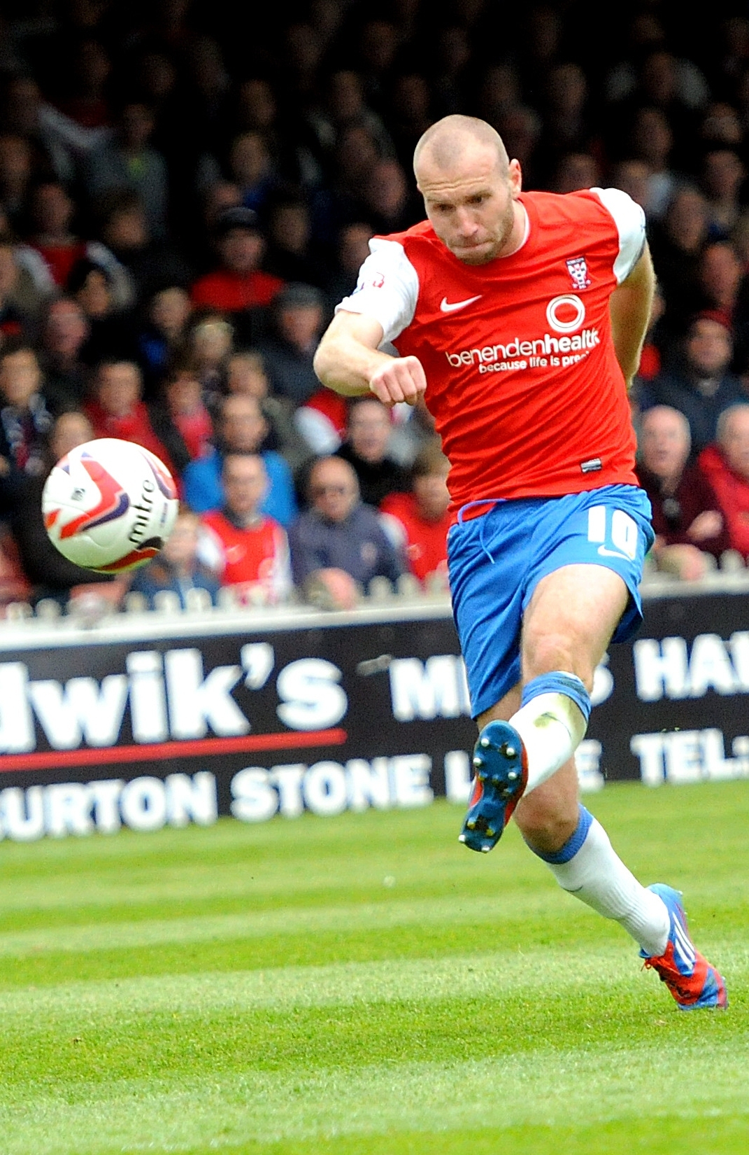 York City's Russell Penn shoots during the match at Bootham Cresent.