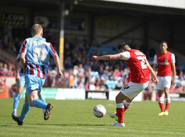 Ryan Brobbel curls in York City's opening goal at Scunthorpe