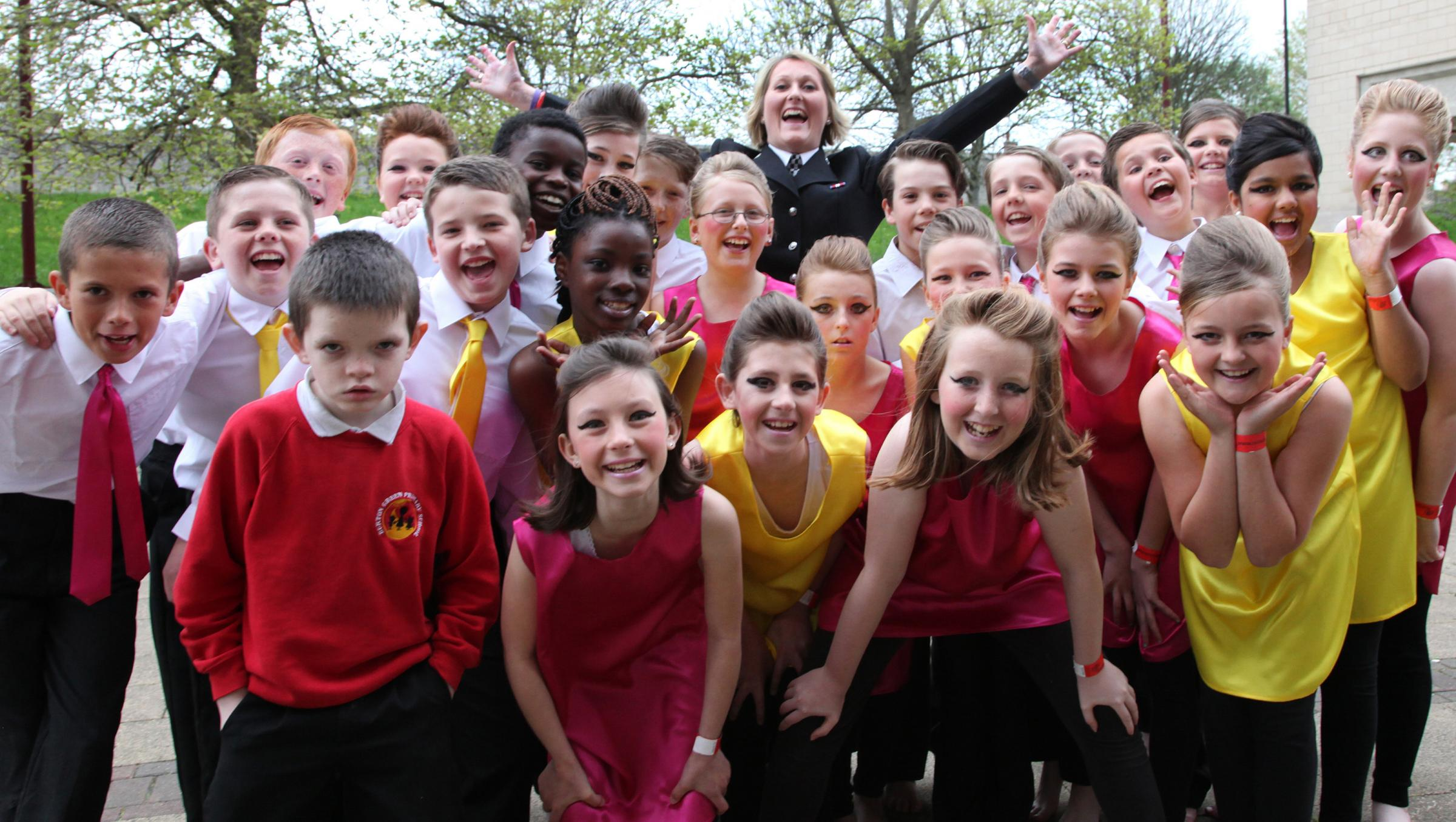 PC Suzanne Asquith, Police Youth Engagement Officer, with children from Burton Green Primary School who took part in Rock Challenge, a national dance competition sponsored by North Yorkshire Police, at the Barbican