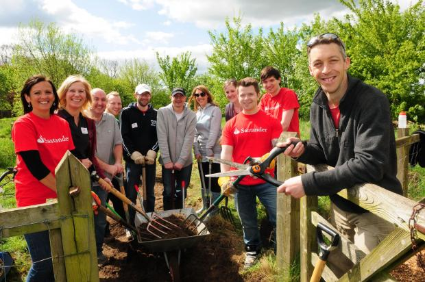 Nigel Wright with fellow Aviva and Santander staff gardening at Poppleton Ousebank school.pic: Anthony Chappel-Ross (5932212)