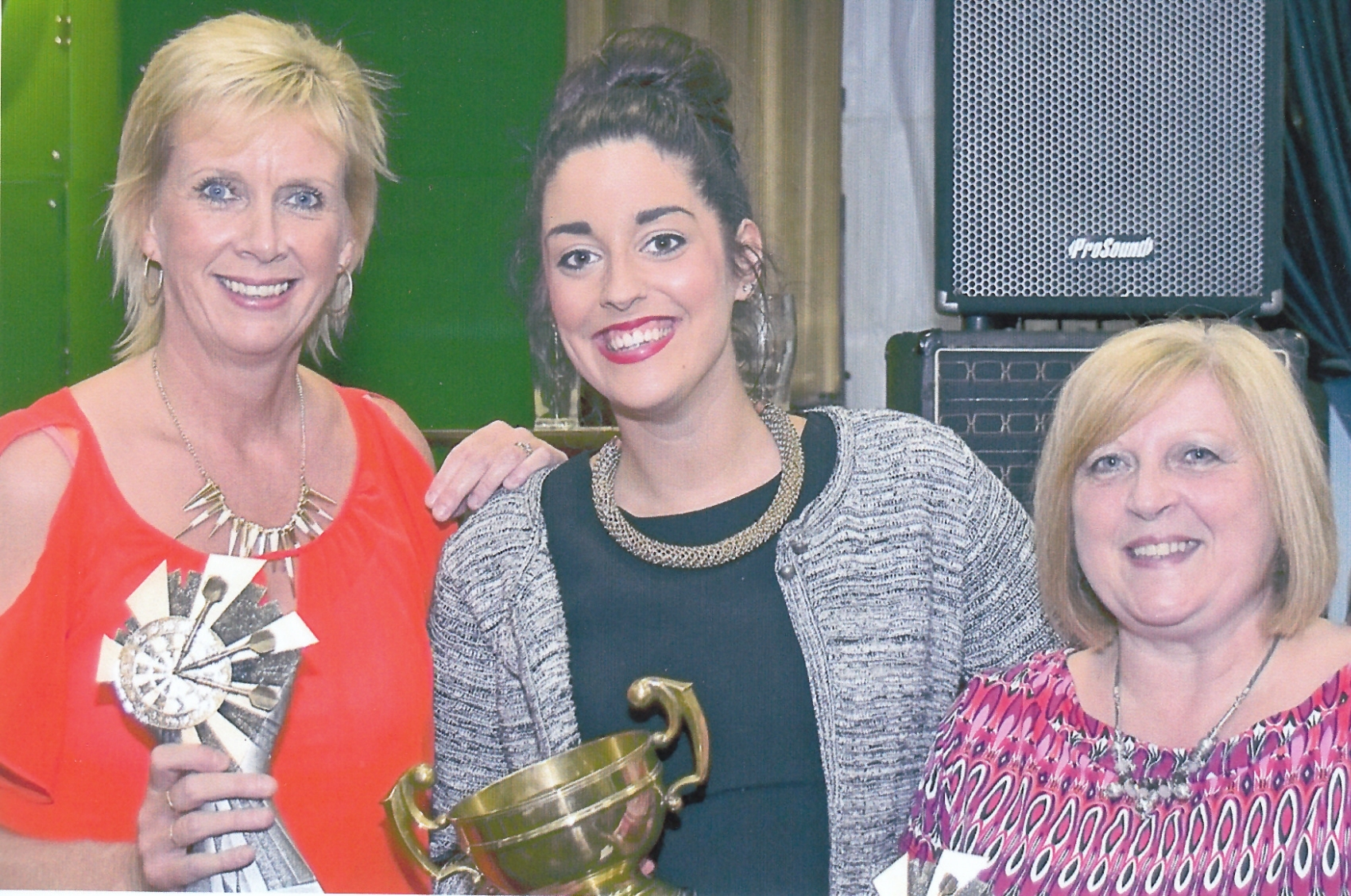 Individual champion Tracey Farmeary, left, at the York John Smith's Ladies Darts League finals night with Sara Buckle, of John Smith's, centre, and runner-up Sue Lowery