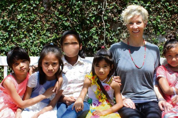 York dentist  Andrea Ubhi at the Asha Nepal Reintegration Centre in Kathmandu with girls who have been victims of sex trafficking.