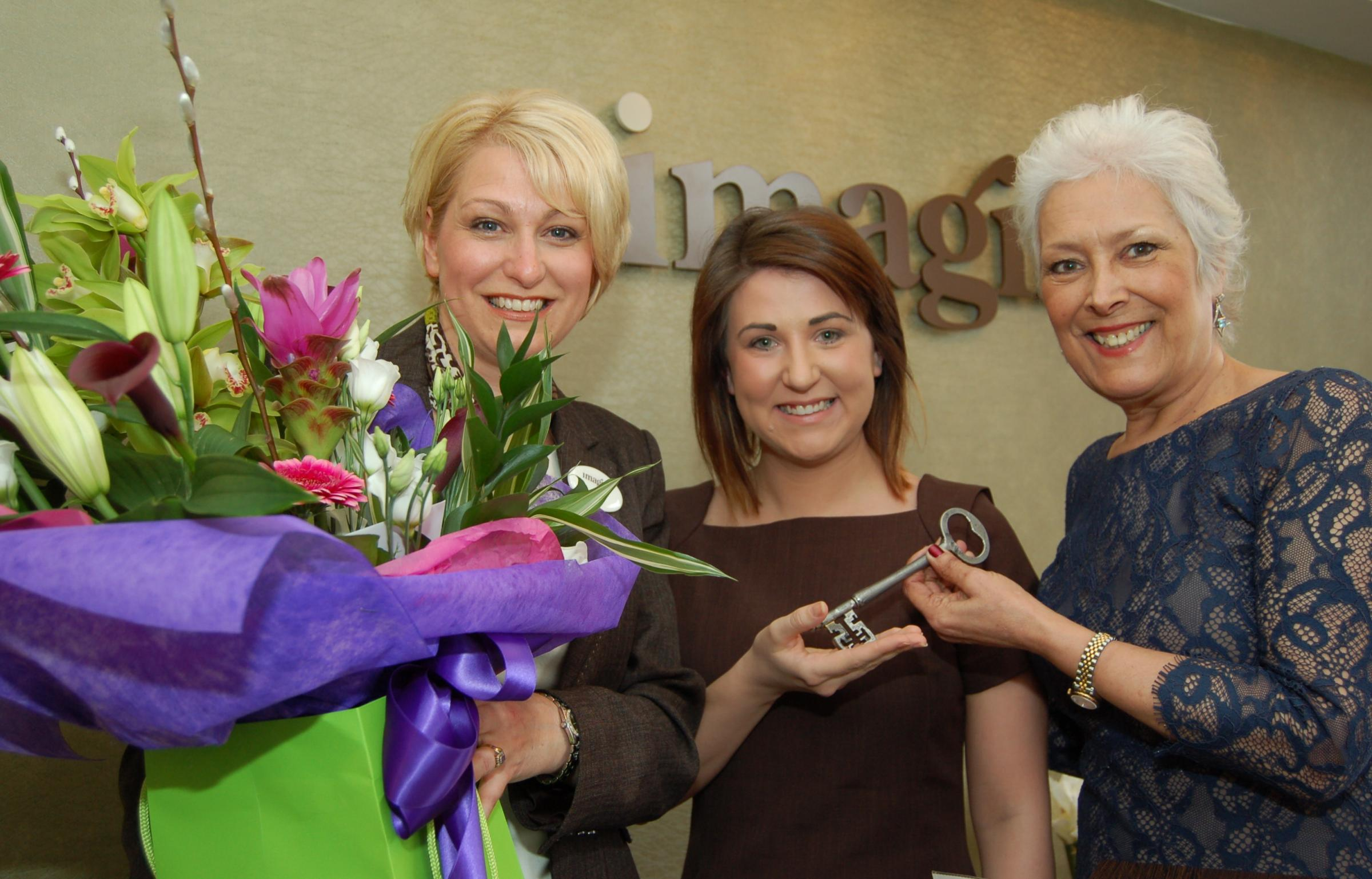 Lynda Bellingham OBE hands over the key to the door at the official opening of the new Imagine Spa to Spa Manager Lauren Cusworth and Wendy Butcher, left. Picture: Wendy Binns