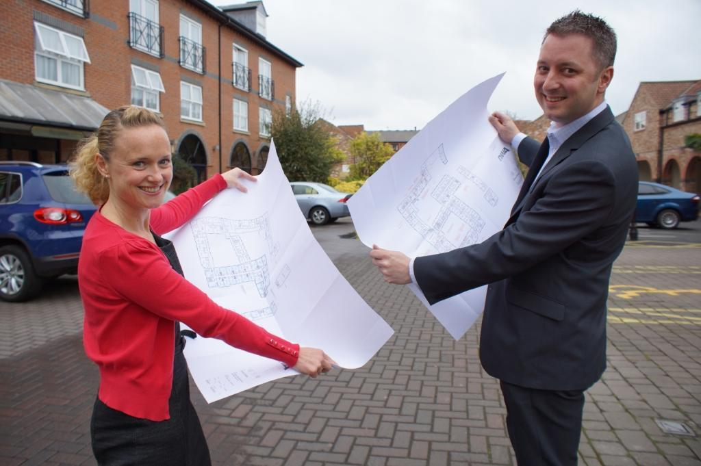 Monkbar Hotel general manager Graham Usher and sales manager Nikki Brannan view plans for the hotel's £3m transformation