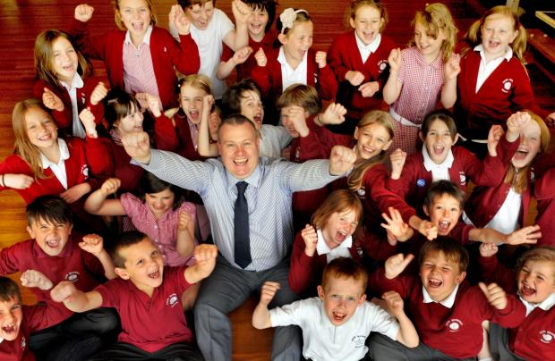 Teacher of the Year 2013 Andy Daniel with pupils at Ralph Butterfield School