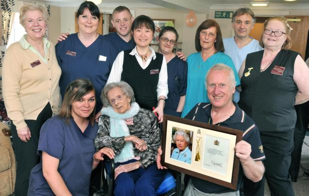 Joan Pengelly celebrates her 100th birthday with her son Owen (right) and staff at Birchlands, Haxby.