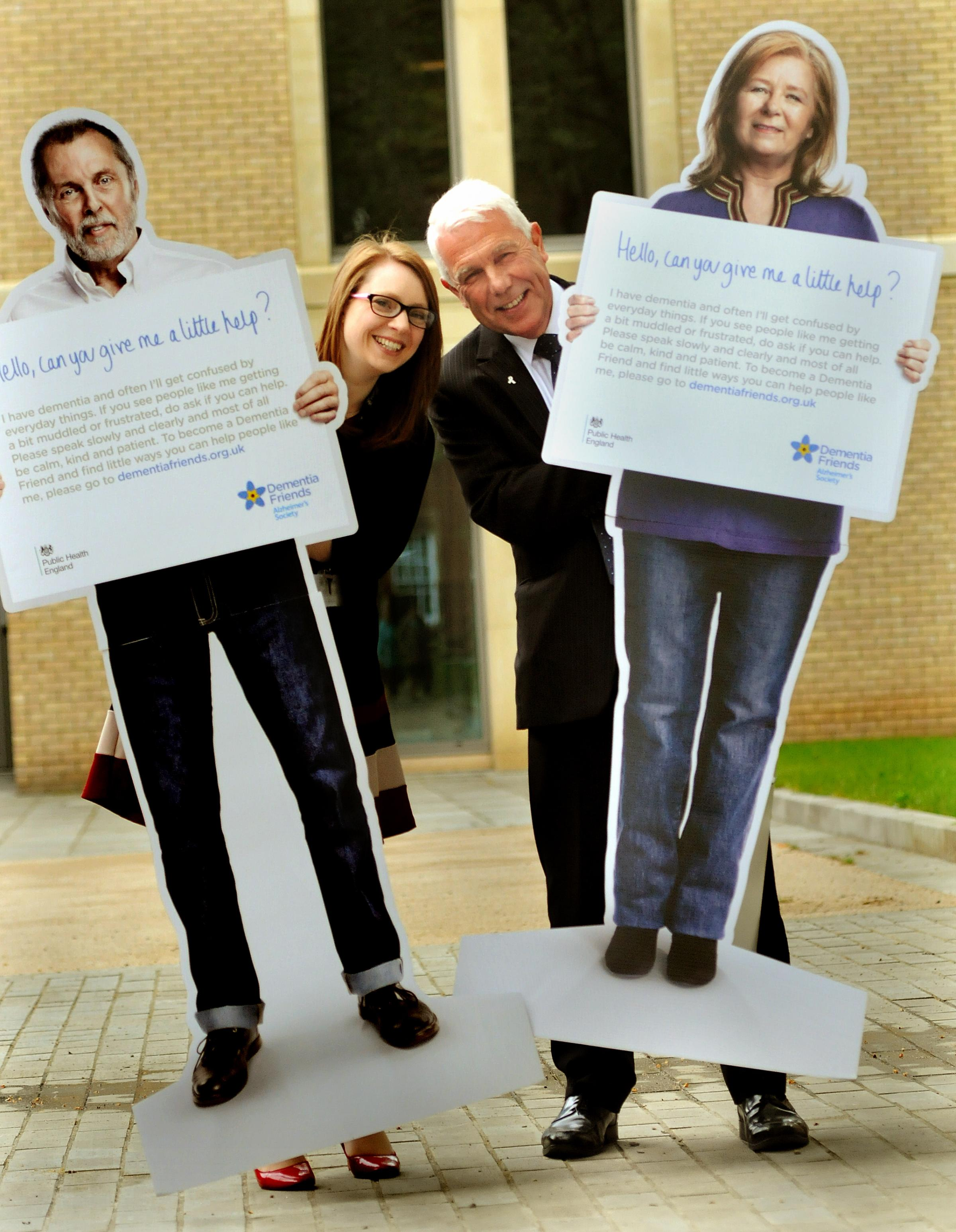 Dr Paul Edmondson-Jones and Cllr Linsay Cunningham-Cross at the launch of the Dementia Friends campaign with two of 12 life-sized cut-outs