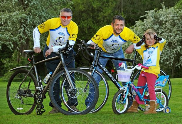 CHAIN REACTION: John Sanderson, left, and Mark Howard, who are cycling from Bridlington to Wistow on Saturday to raise money for Brain Tumour Research pictured with Mark's daughter Olivia, aged five