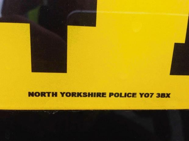 The number plate on the 'unmarked' police car