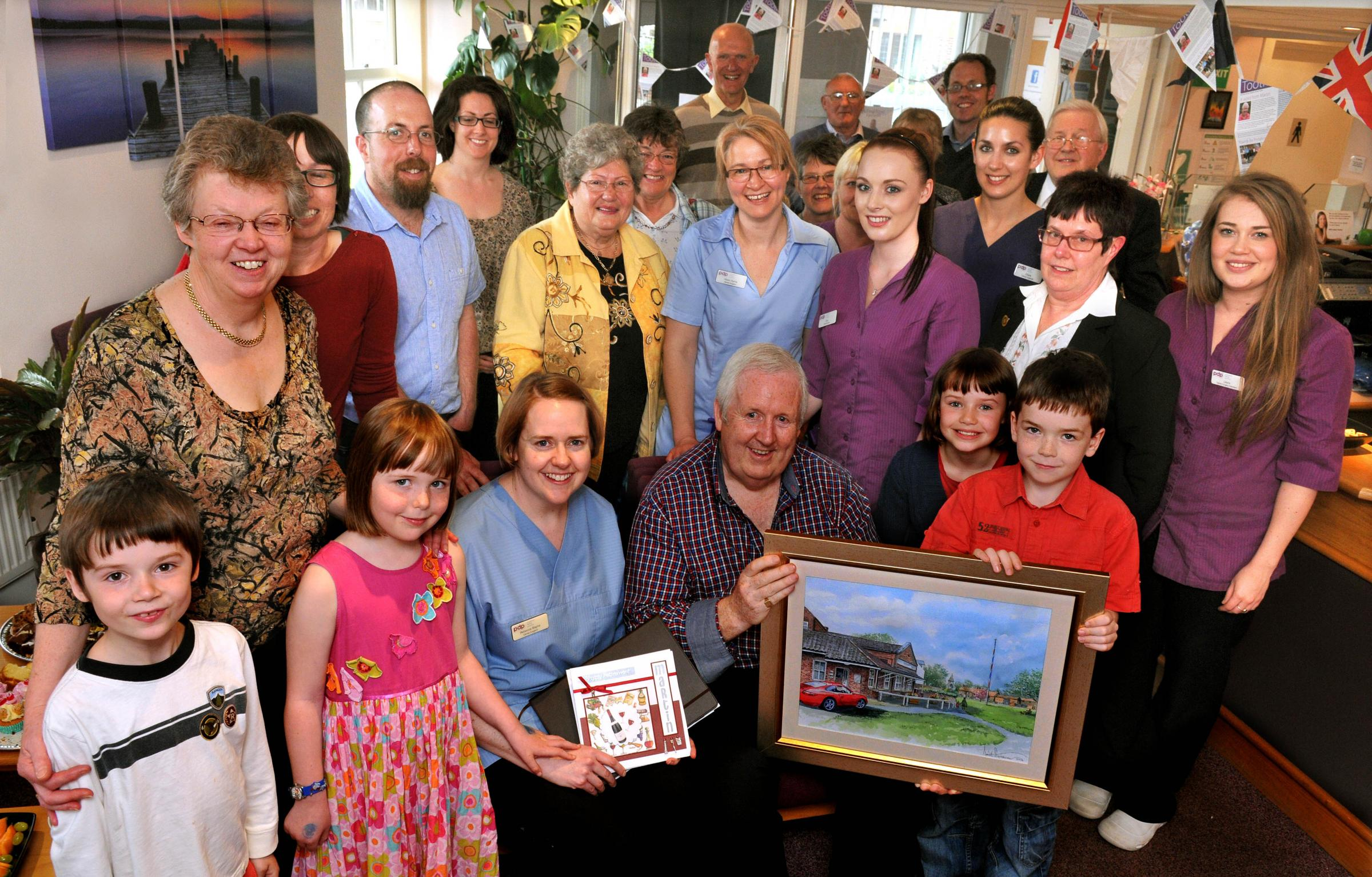 Dental surgeon Martin Bayne who is retiring after 42 years at Poppleton Dental Practice celebrates with family and colleagues. Picture: Nigel Holland.