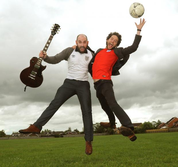 Huntington School teachers Ian Wilson, left, and Robin Parmiter who recorded a World Cup anthem for the England World Cup campaign in Brazil called Bring It Home