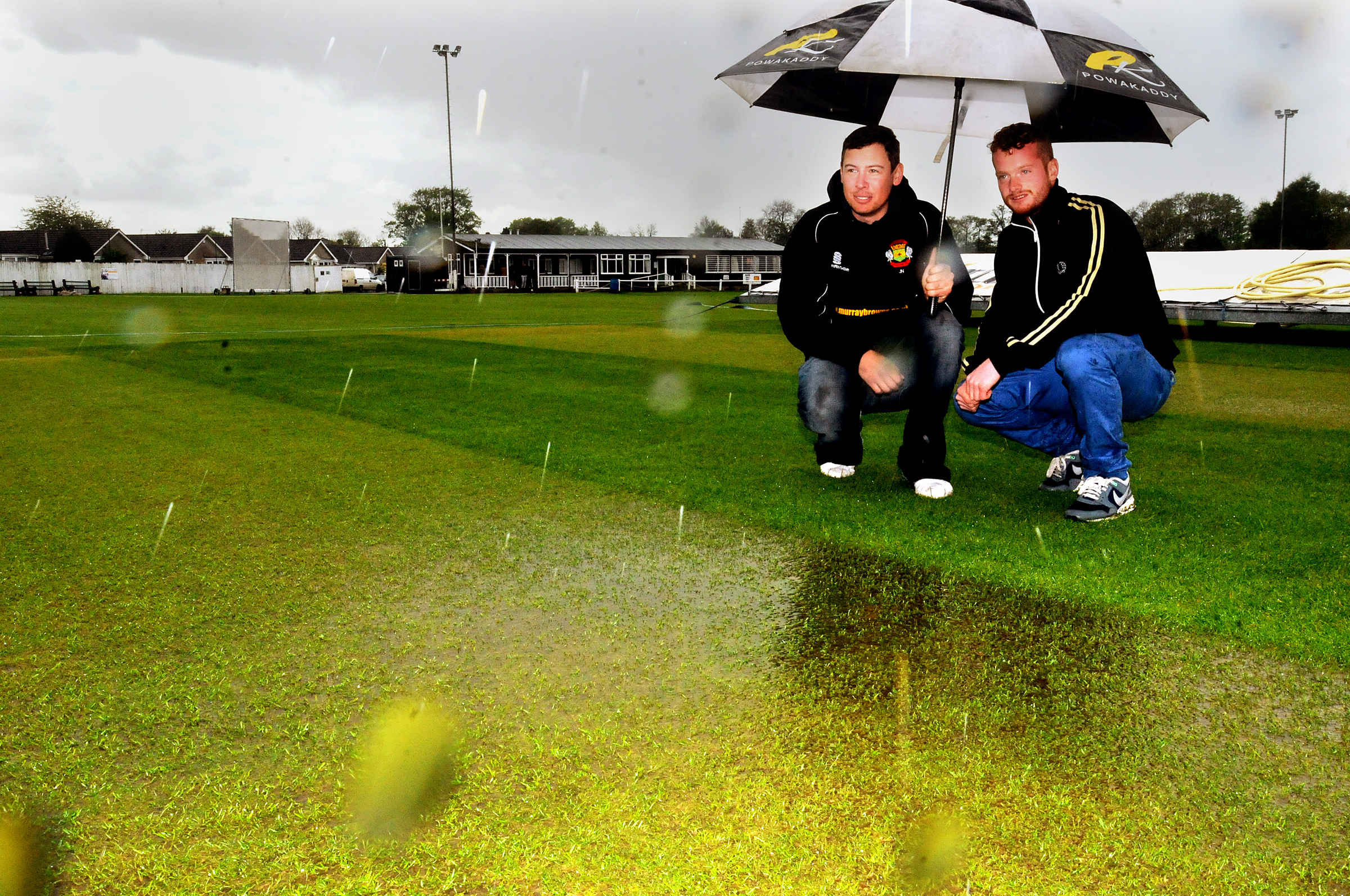 Captains (left) Jamie Nesfield of Folkston and Flixton and Ryan Boyes of Pickering consider the water logged state of the ground at Pickering