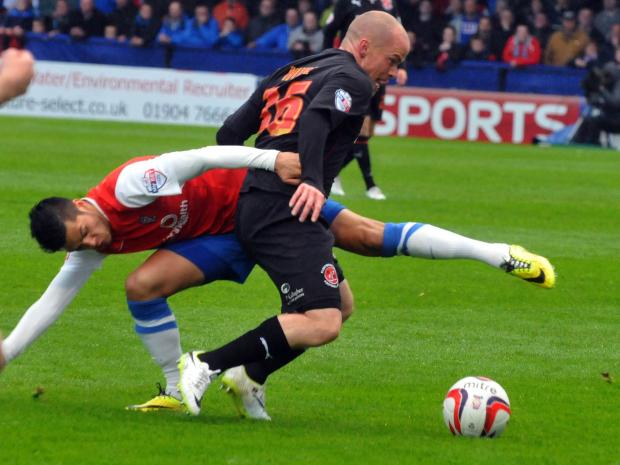 York City midfielder Adam Reed in action during the play-off semi-final against Fleetwood