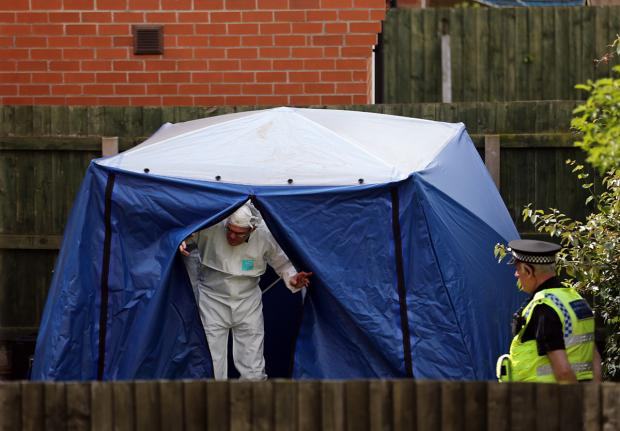 York Press: An officer leaves the forensic tent at Burnholme Grove today.