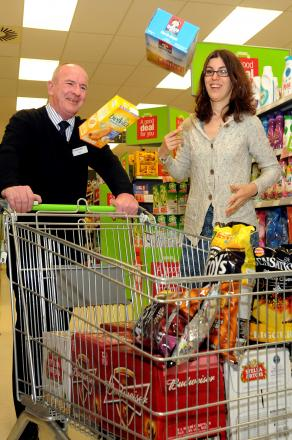 JUST THE TICKET:Helen Aitchison, from Survive, and Grant Fawcett, Manager of the Co-op Store, in Hull Road, York, prepare for the charity trolley dash to raise funds for the sexual abuse charity. Picture: Garry Atkinson