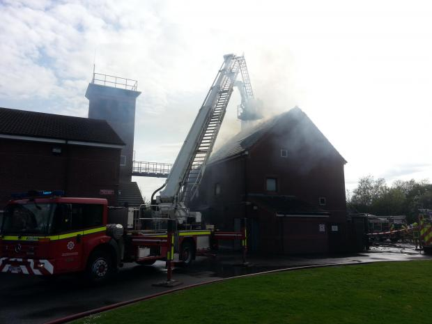 Firefighters tackle the blaze at the fire training centre