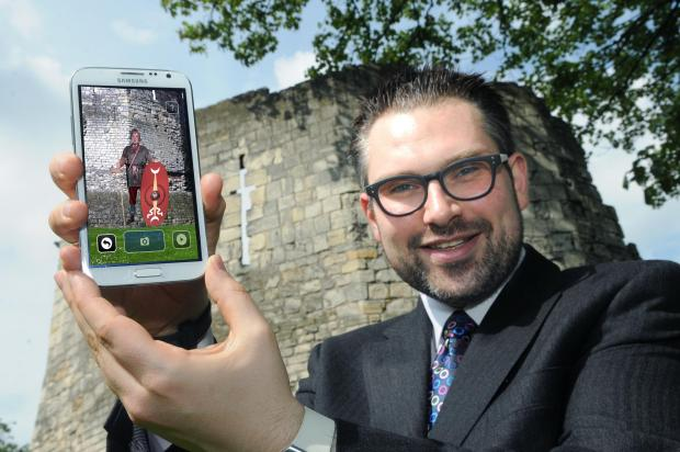 Cllr James Alexander, leader of City of York Council, with one of the smartphone holograms at the Multangular Tower, in the Museum Gardens