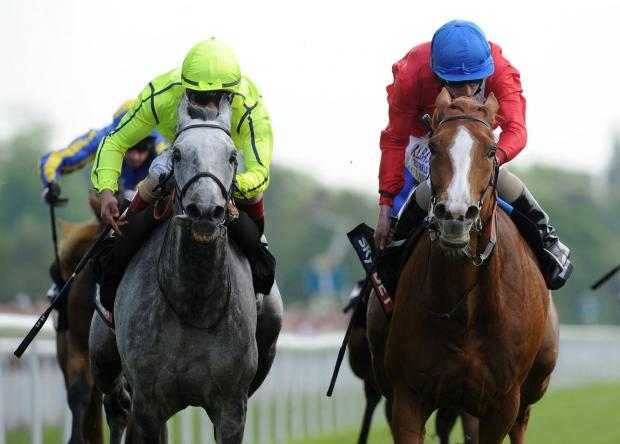 Gospel Choir ridden by Ryan Moore, right, beats Tac de Boistron. Picture: Anna Gowthorpe/PA