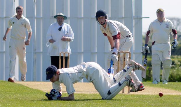 Sheriff Hutton wicketkeeper Joe Schofield dives in an attempt to save runs off the bowling of his brother, Nick, against Ripon
