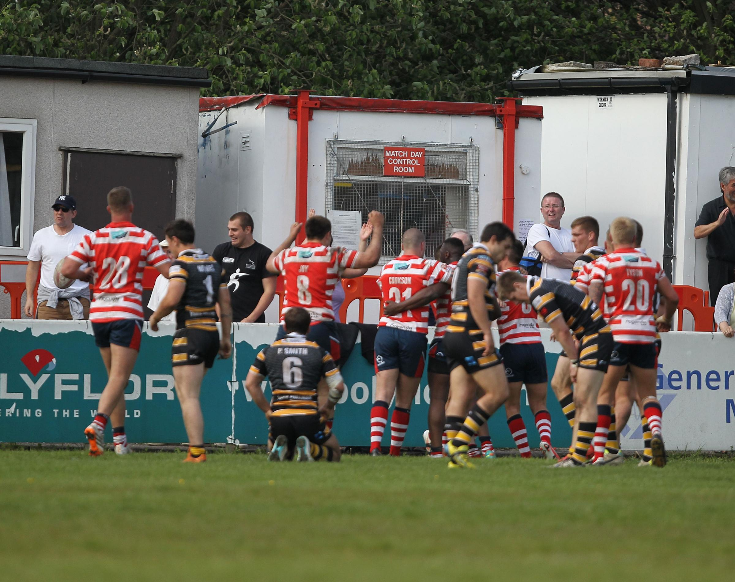 York City Knights players are distraught as Oldham score the match-winning try in Championship One